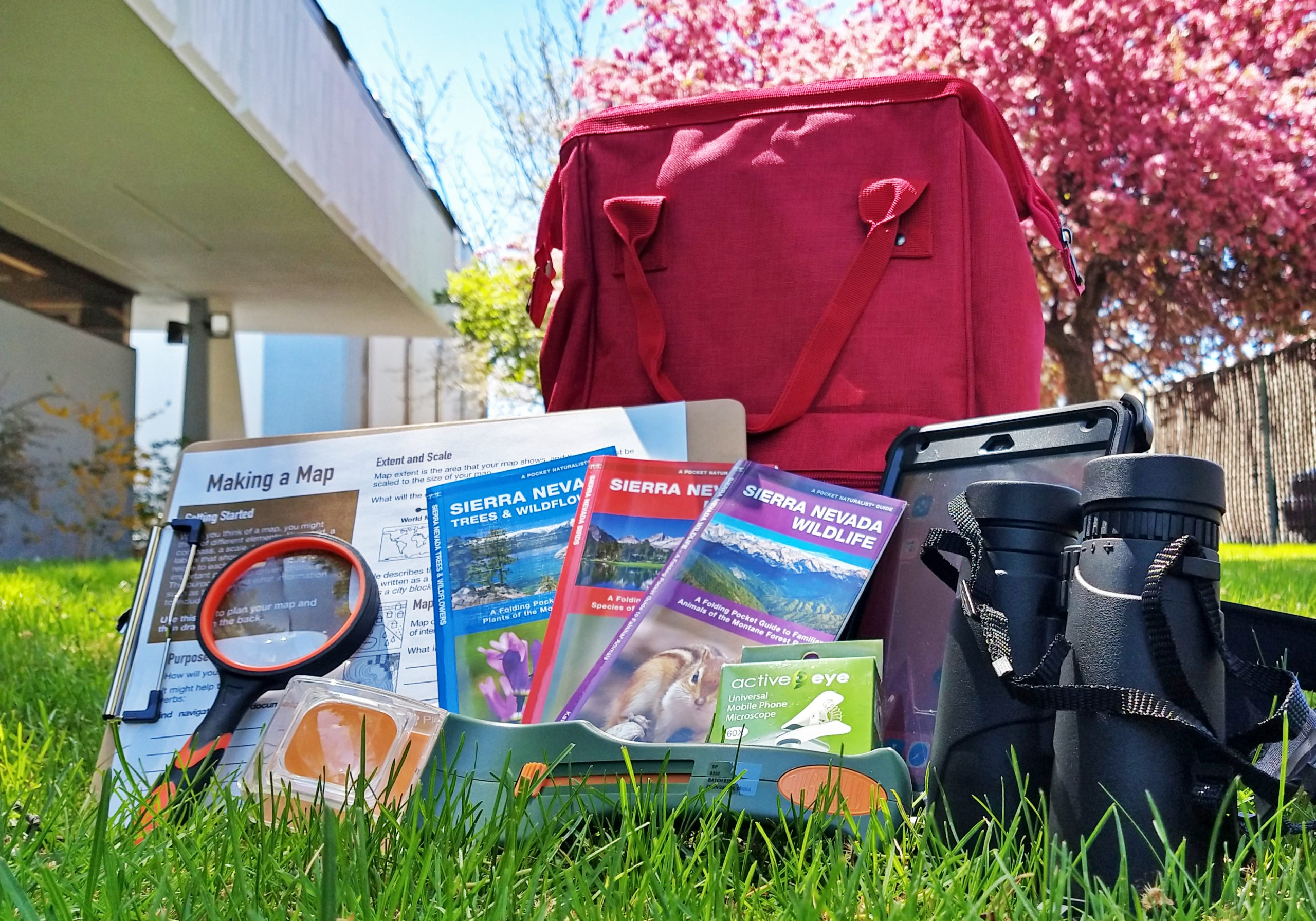 Community Science Backpacks are available for checkout and use in the library's garden. The backpacks include tools for observing and recording nature in the garden